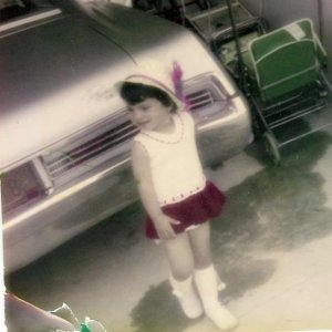 Little Libby in the driveway of her PR home